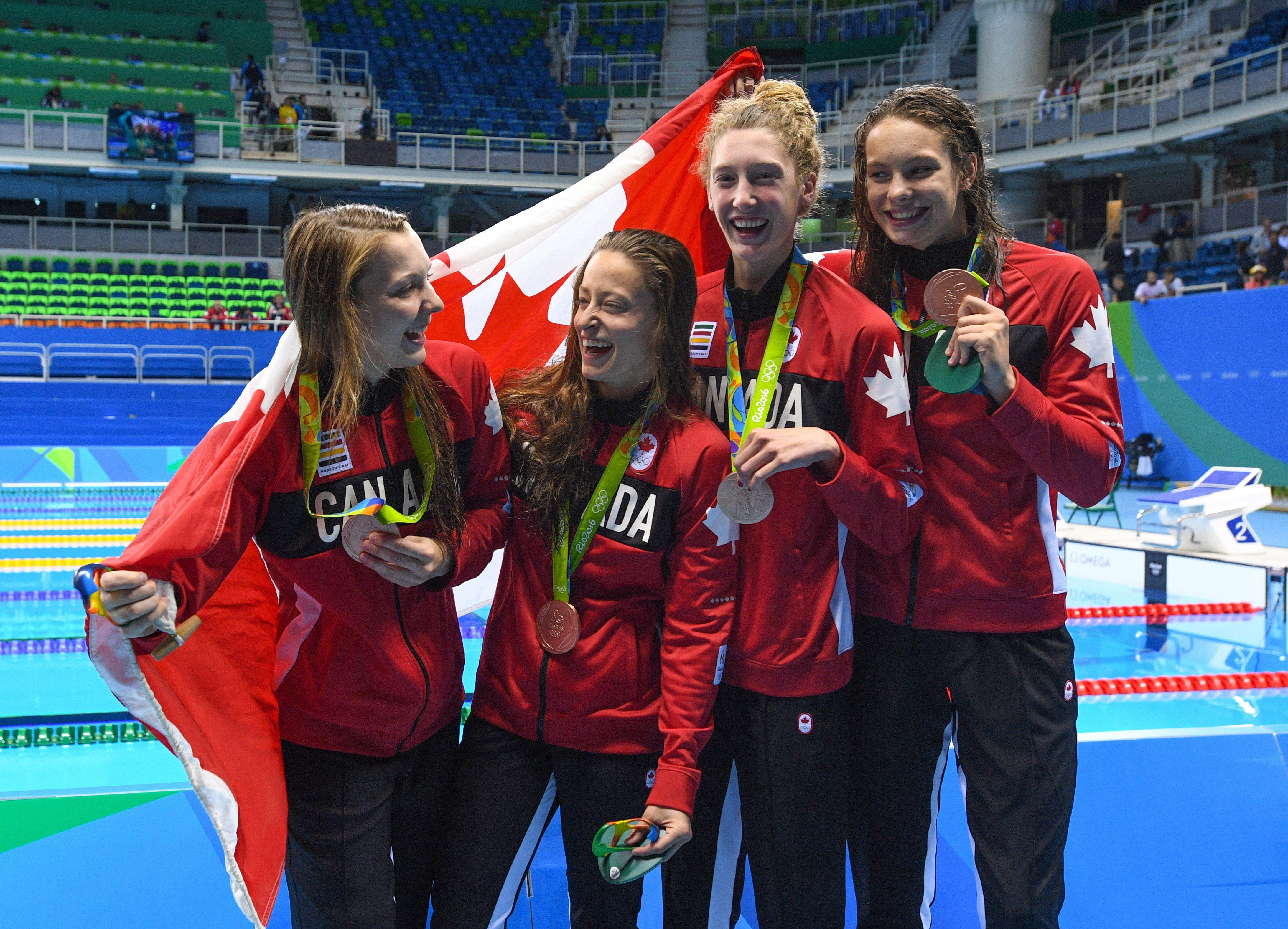 Canada's Brittany MacLean, Katerine Savard, Taylor Ruck, and Penny Oleksiak take bronze in the women's 4 x 200-metre freestyle relay during the 2016 Olympic Summer Games in Rio de Janeiro, Brazil in Wednesday, Aug. 10, 2016. THE CANADIAN PRESS/Sean Kilpatrick